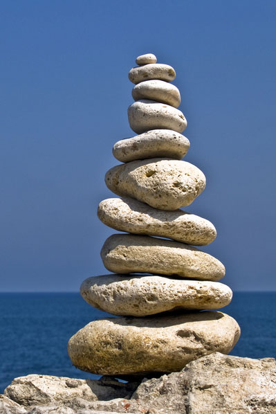 image of stacked stones by the sea